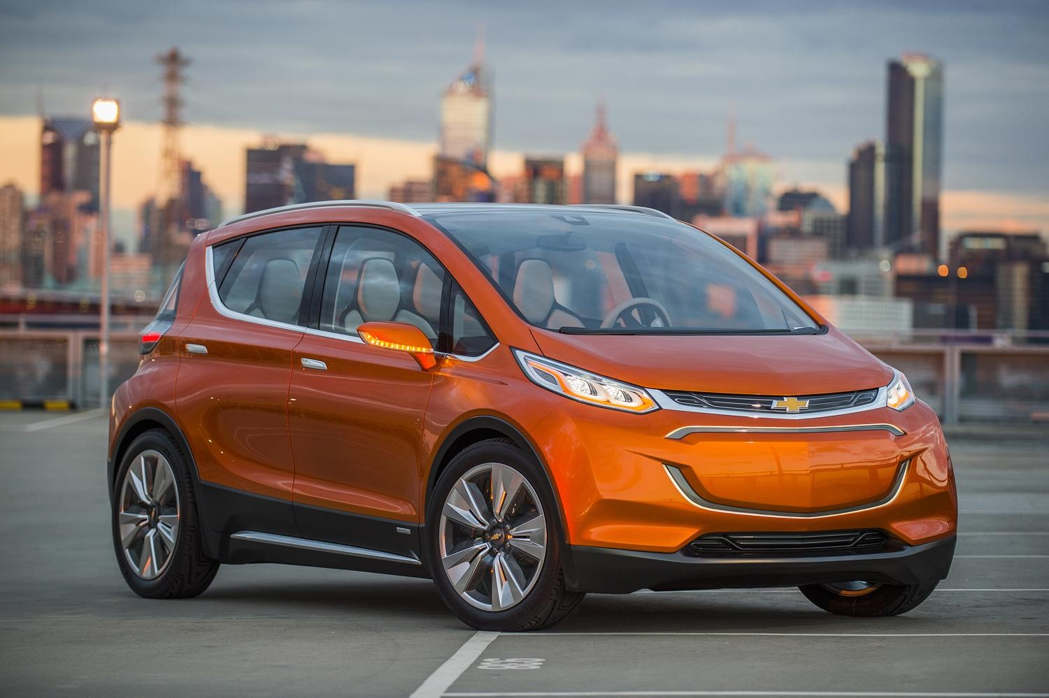 Chevrolet's Bolt, an all-electric car expected in showrooms as soon as 2017, will be able to travel 200 miles between charges and cost around $30,000 after government incentives, General Motors says.